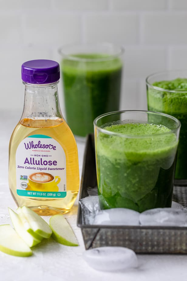 3 cups of the detox kale smoothie recipe shown with the Wholesome Allulose sweetener bottle