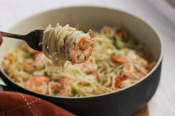 Savory, succulent Garlic Butter Shrimp Spaghetti paired with a light and airy spaghetti – an easy and quick dish for the weekday menu.