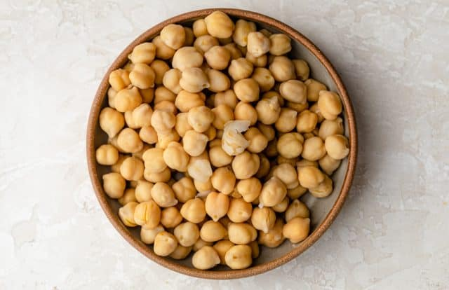 Dried chickpeas from can in a large bowl