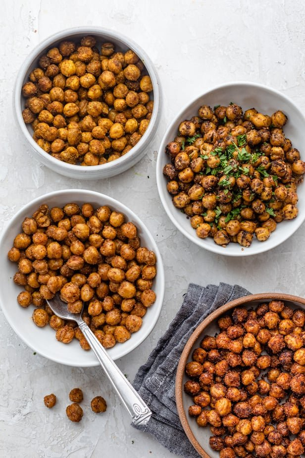 4 bowls of roasted chickpeas each with different spices