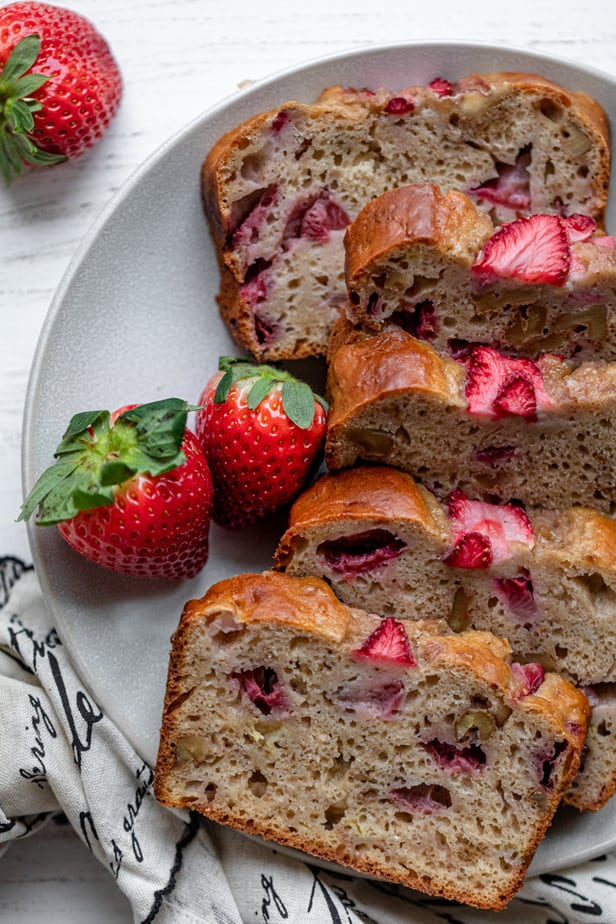 Final strawberry banana bread sliced on a plate