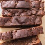 Chocolate cinnamon banana bread sliced on cutting board