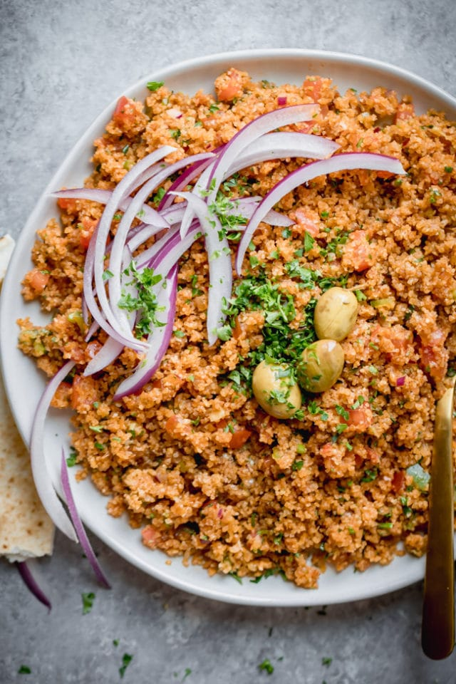 Bulgur pilaf plated with onions and green olives
