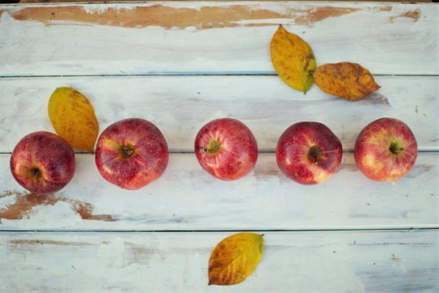 Seasonal apples on a wooden surface