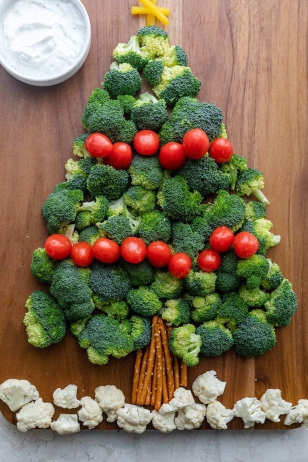 Christmas Tree Vegetable Platter made with broccoli, tomatoes, pretzels cauliflower and yellow peppers, served with a ranch dip