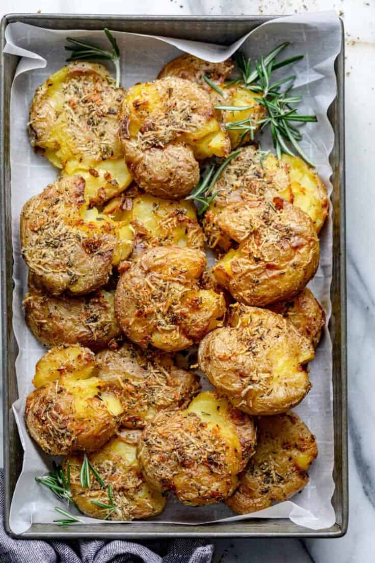 These Rosemary Garlic Smashed Potatoes are a best of both worlds potato recipe - mashed and roasted! They are soft on the inside, crispy on the outside and bursting with rosemary garlicky flavor. It's a creative healthy side-dish the whole family will love!