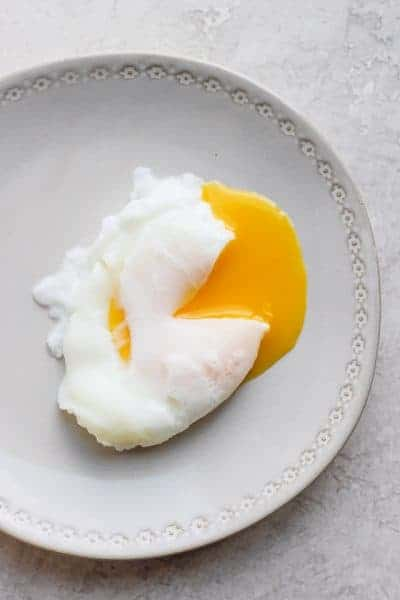 Poached egg on a gray plate