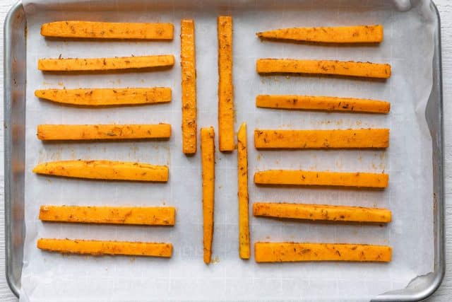 Fries on a baking sheet before baking