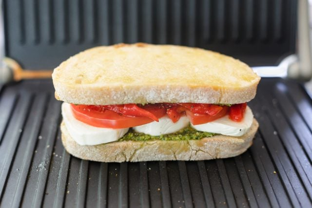 Sandwich assembled in the panini before grilling