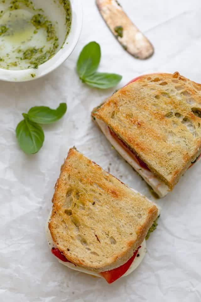 Grilled Mozzarella Sandwich made with walnut pesto, tomatoes and roasted red peppers
