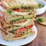 This Mozzarella Sandwich is made with fresh tomatoes and walnut pesto grilled with sourdough bread. It's easy to assemble and bursting with flavor!
