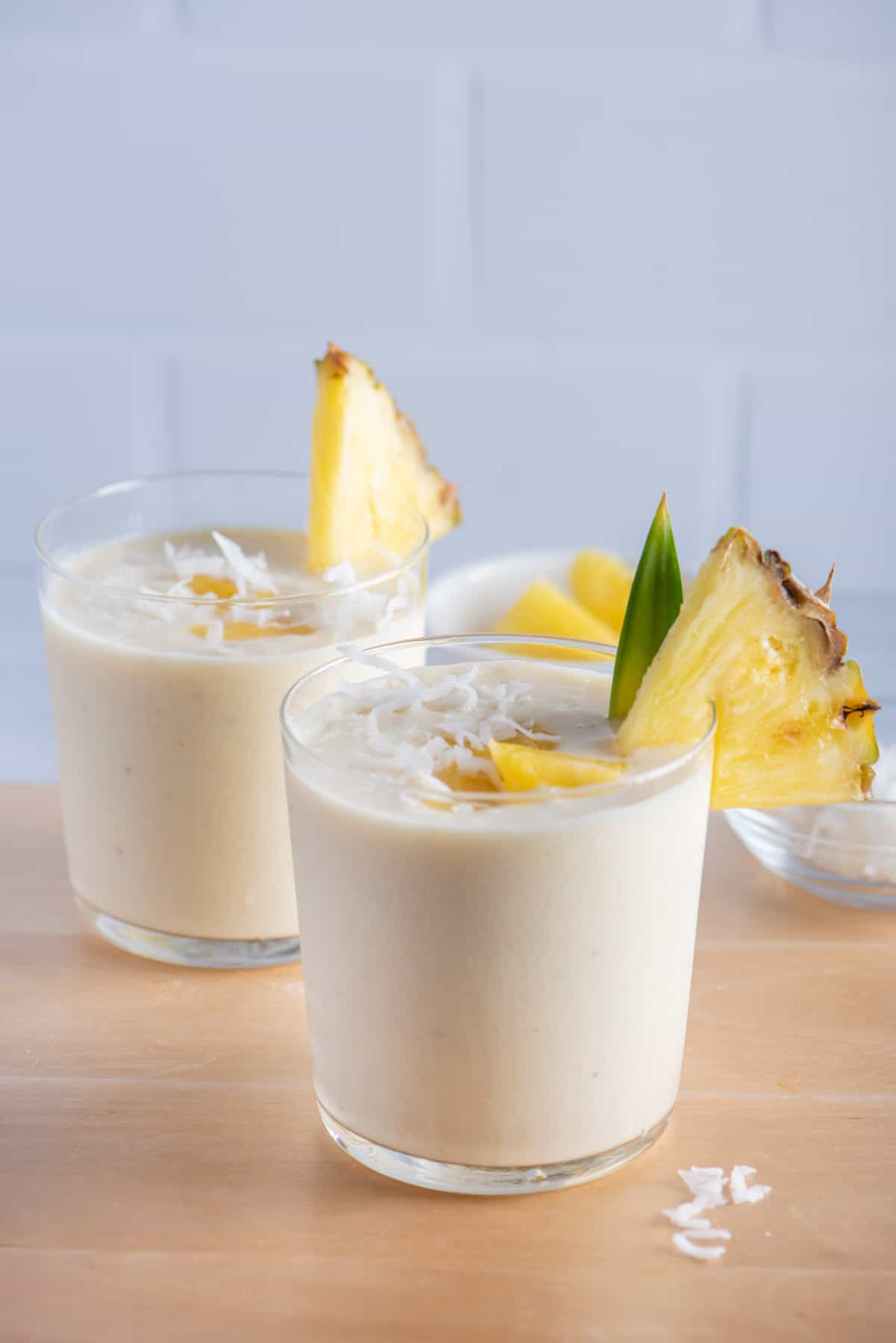 Two cups of pina colada smoothies