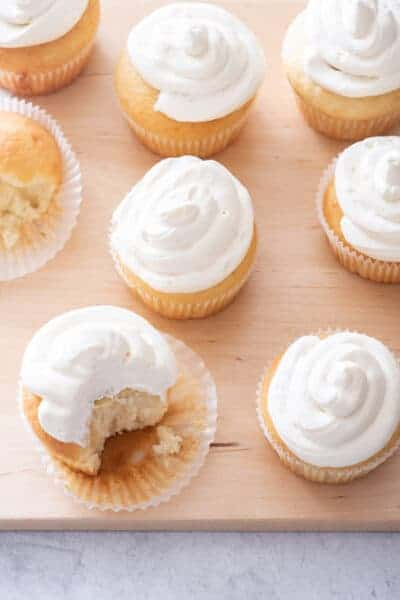 Vanilla cupcakes with bite taken out of one to show consistency