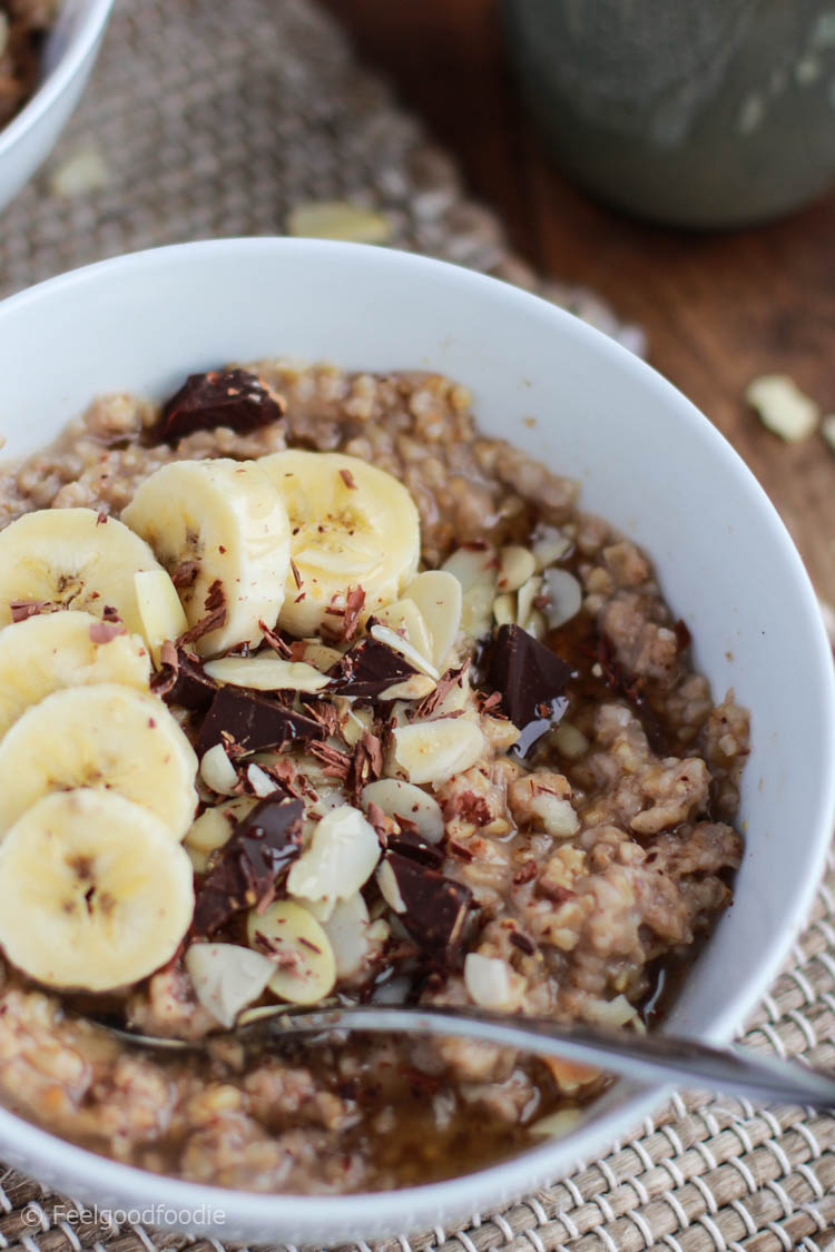 Hands-free yummy Baked Steel Cut Banana Oatmeal prepared in the oven - perfect for entertaining guests at breakfast or meal prepping breakfast for the week!
