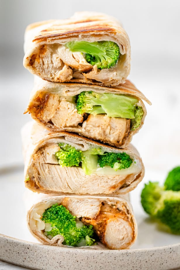 Chicken and broccoli wraps stacked on top of each other