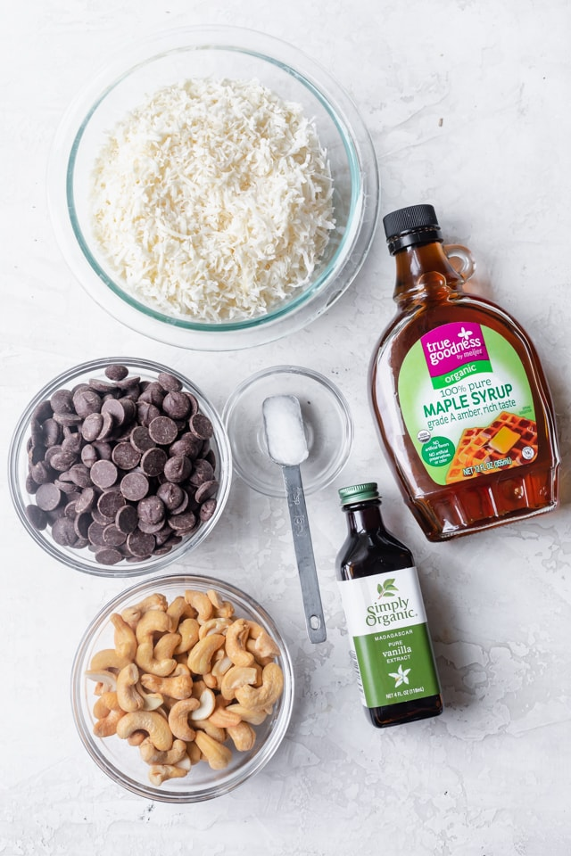 Ingredients to make chocolate coconut balls: coconut, chocolate, cashews, maple syrup, coconut oil and vanilla extract