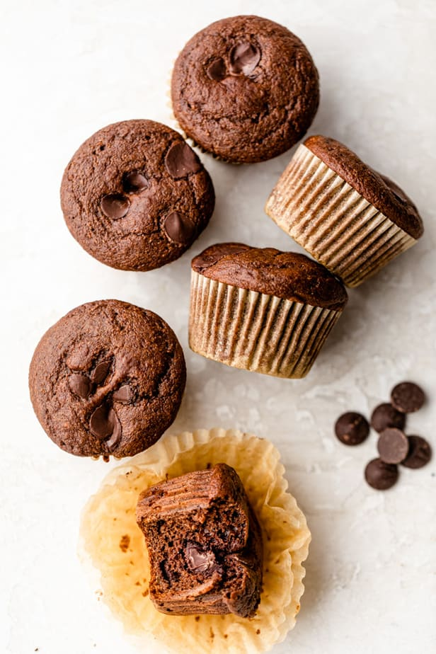 Double chocolate chip muffins on white surface