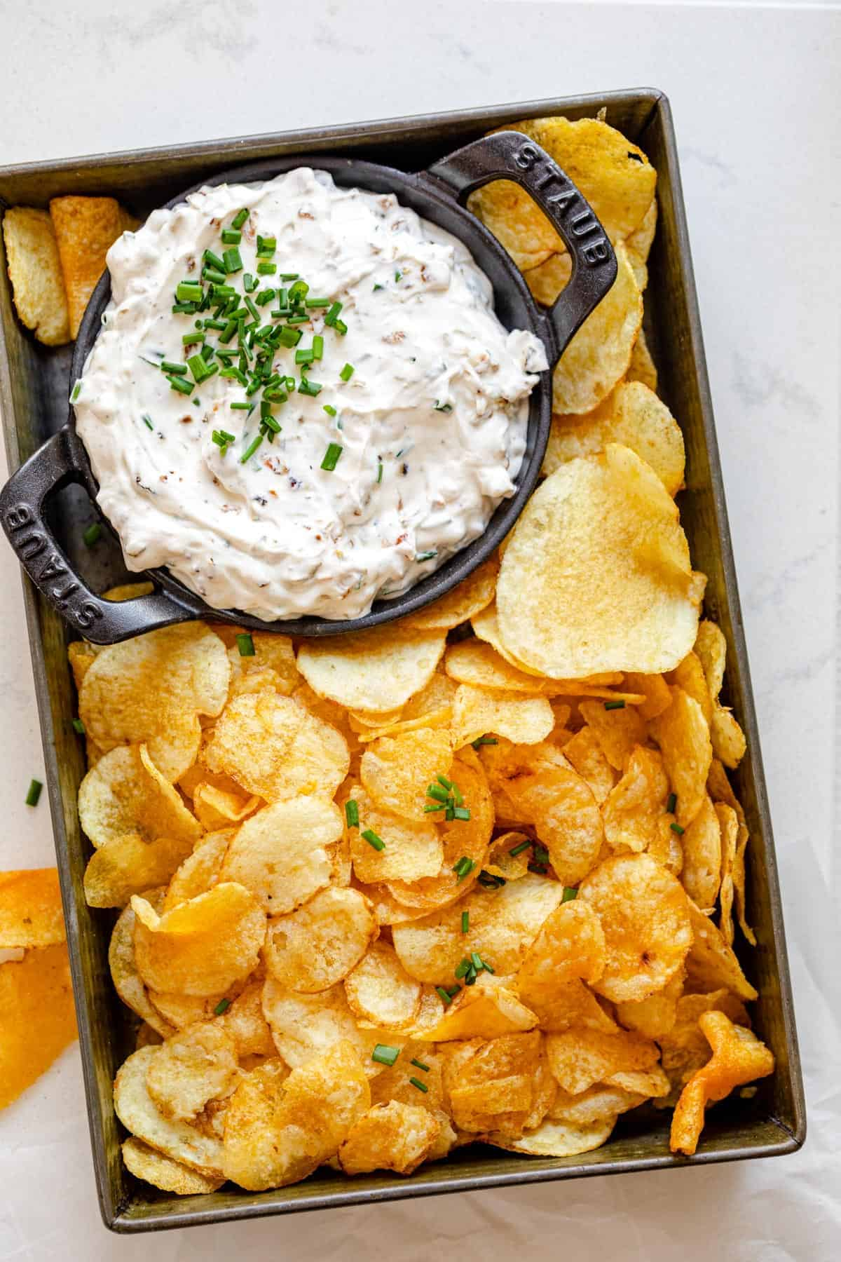 Skinny French Onion Dip in a white bowl with sliced vegetables