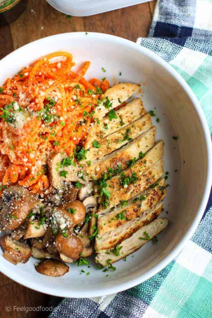 Delicious spiralized Sweet Potato Noodles with Grilled Chicken & Mushrooms  in a white bowl