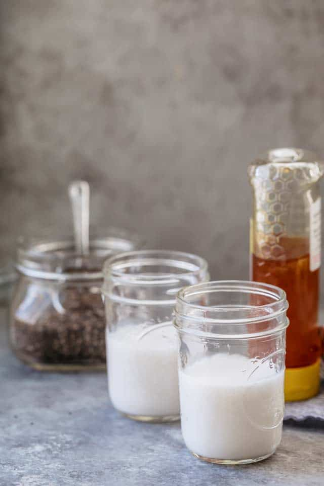 Ingredients to make 3-Ingredient Chia Pudding - almond milk, chia seeds and honey