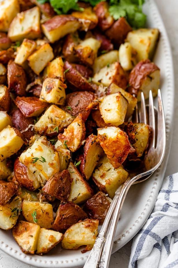 Garlic Parmesan Roasted Potatoes in a long serving dish