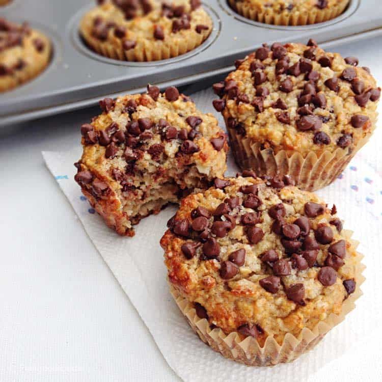 close up of Gluten-Free Banana Chocolate Chip Muffins on a paper towel