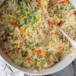 One pot chicken and rice is in a large pot