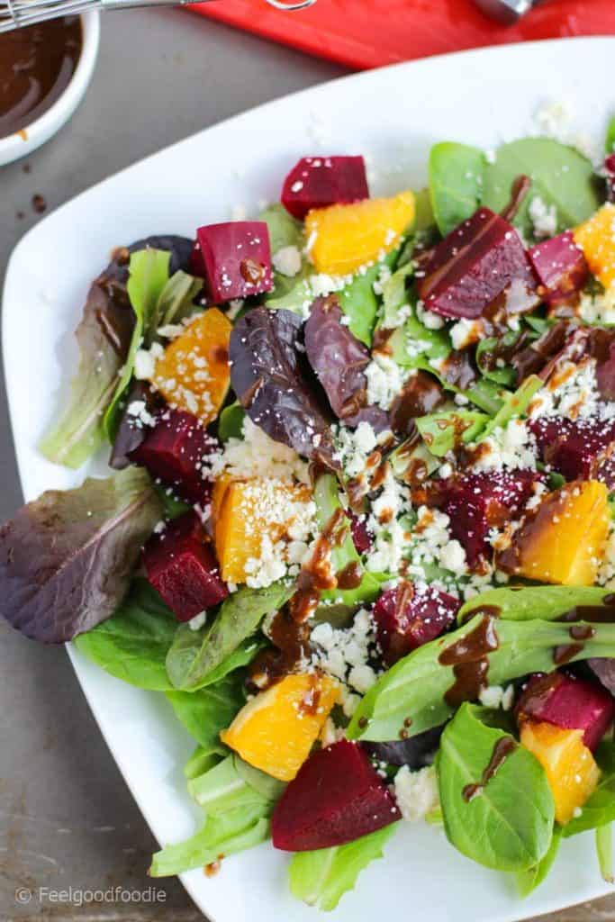 Orange Red Beets Feta Spring Salad on a white dish