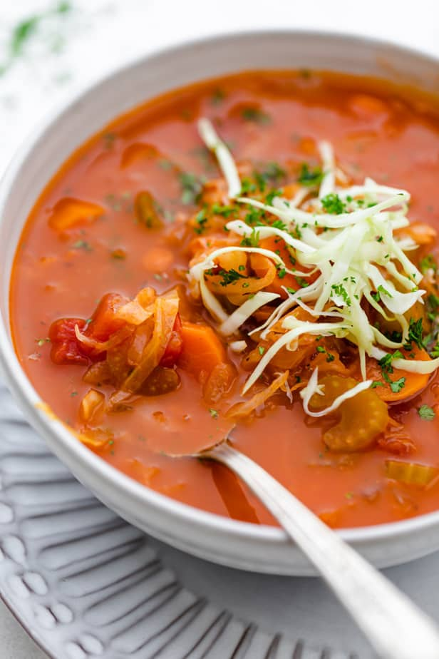 Tomato soup with cabbage in a white bowl