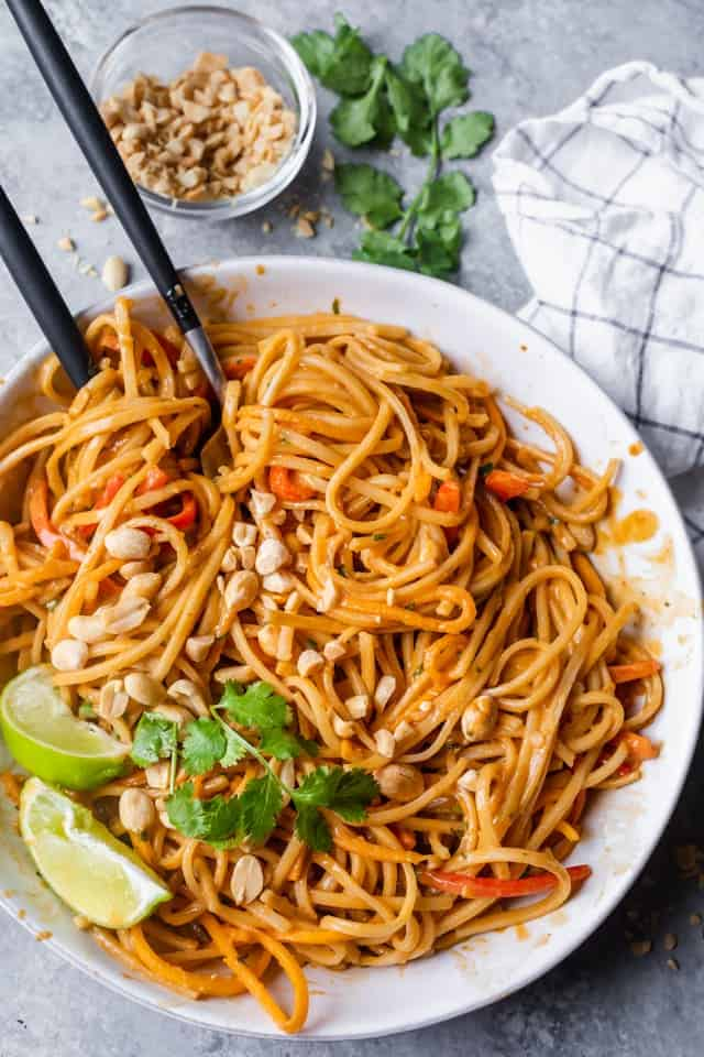 This bright and colorful Asian Noodle Salad is a gluten-free vegan meal that's filled with fresh vegetables and tossed in a spicy creamy nutty dressing | Asian Salad | Noodle Recipes | Healthy Noodles | #noodles #asianfood #healthyrecipes #salad #feelgoodfoodie