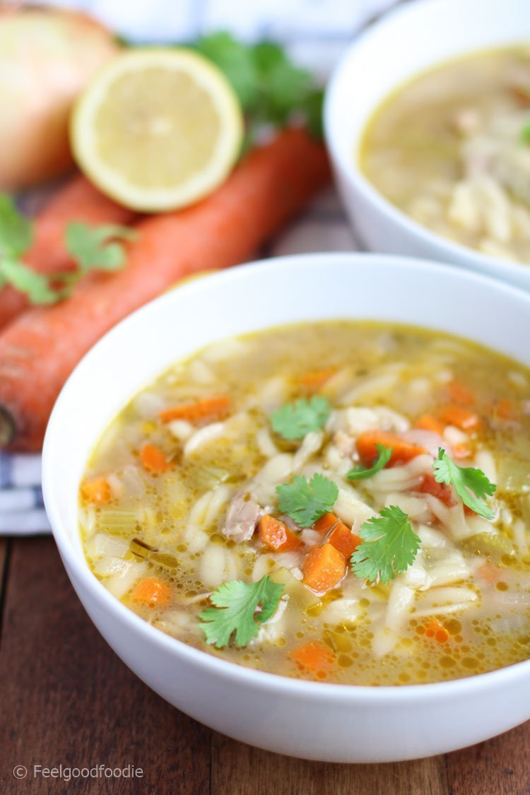 A modern take on chicken noodle soup, this Chicken Lemon Orzo Soup is full of juicy chicken, heart-healthy vegetables and a delightful lemony broth! | Hearty Soup | Pasta Soup | Italian Soup | #soup #orzo #chicken #feelgoodfoodie