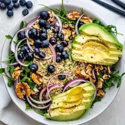 Avocado blueberry salad with arugula and quinoa
