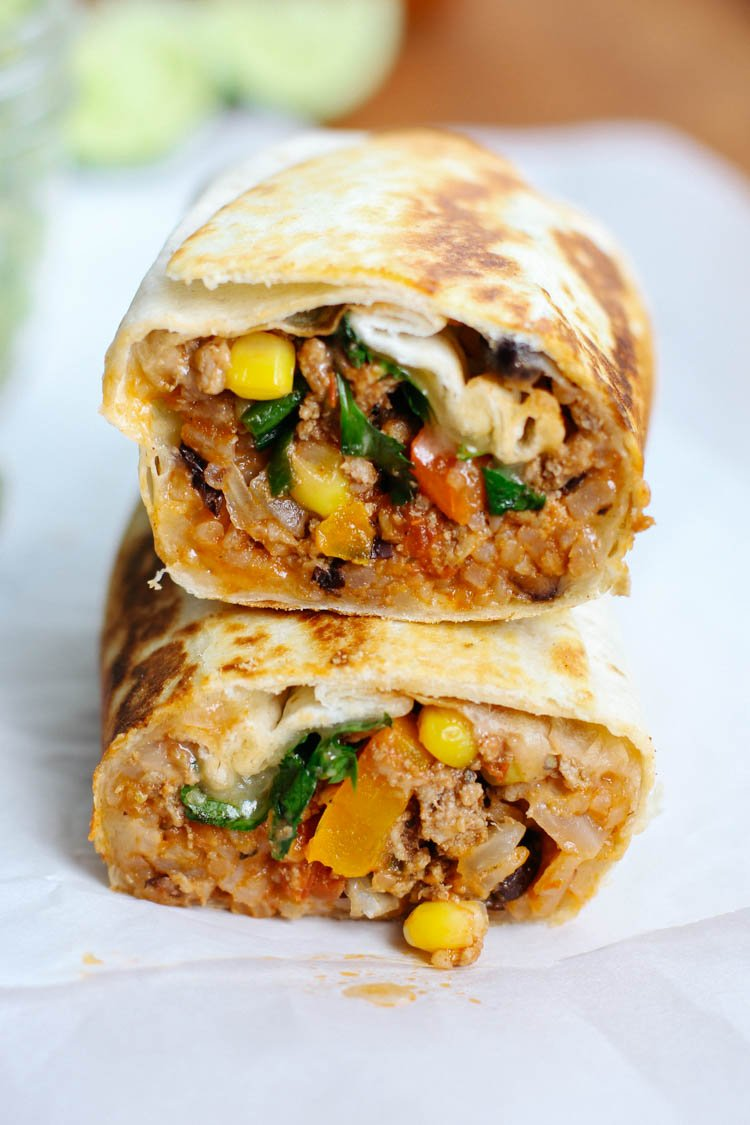 Ground Beef Taco Burritos are a family favorite and a easy weeknight meal to throw together that is full of flavor and texture!