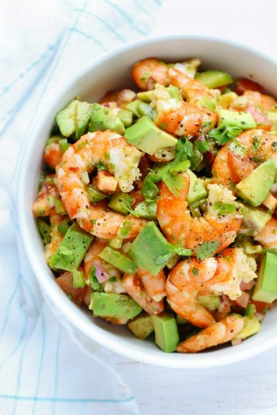 This light and simple Shrimp Avocado Salad uses only a few simple ingredients with a zesty lime olive oil dressing that adds a burst of fresh flavor!