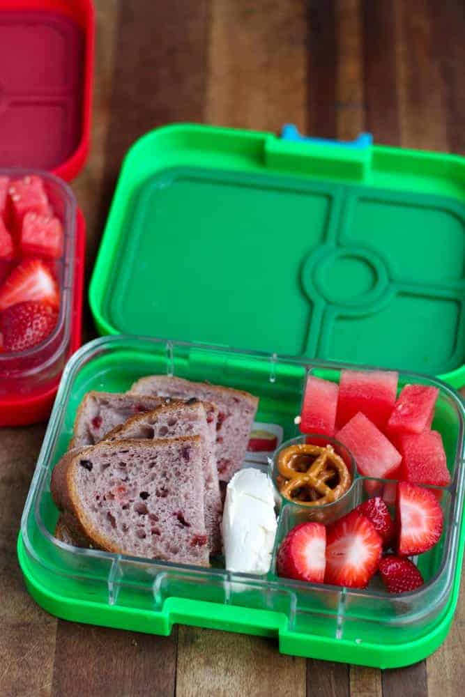 Lunchbox: Cranberry and seed whole wheat bread with cream cheese, fruit and pretzels.