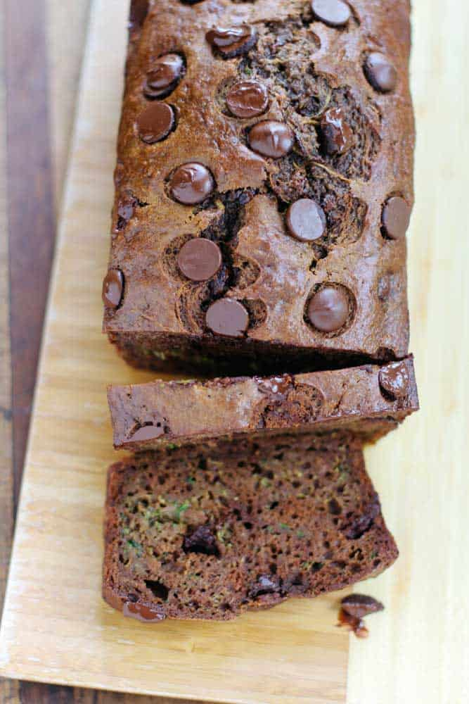 A loaf of chocolate zucchini bread cut into slices