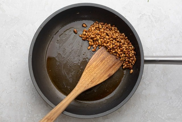 Frying pan with fried pine nuts