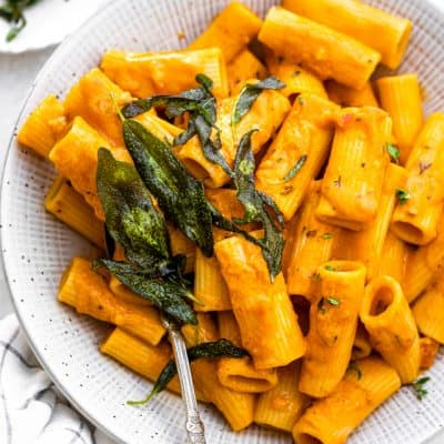 Final Pumpkin Pasta recipe plated in a large bowl and served with crispy sage
