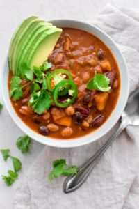 This Sweet Potato Chili is basic in ingredients but sophisticated in flavor - it has a sweet smoky flavor & packed with a healthy dose of protein and fiber!