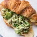 Avocado chicken salad served in a croissant for an easy lunch sandwiche