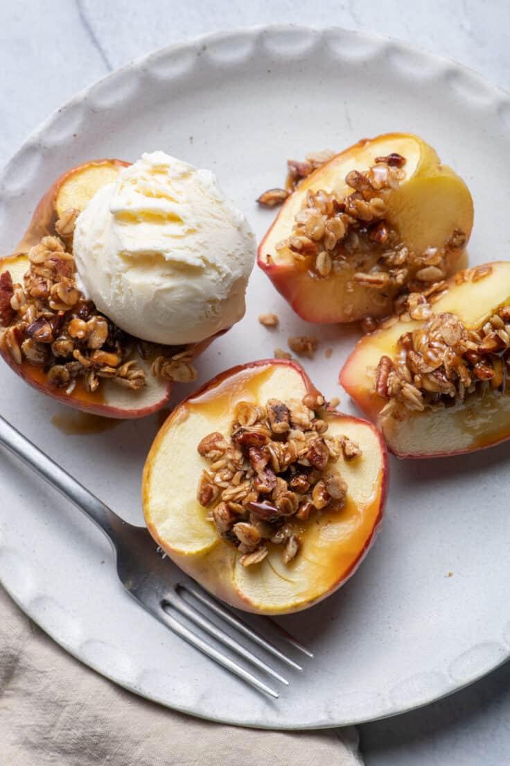 Cinnamon Baked Apples with Oats & Pecans mixture on top and scoop of vanilla ice cream