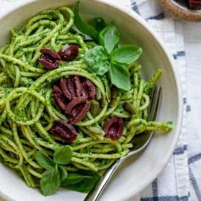 Pumpkin seed pesto pasta topped with kalamata olives
