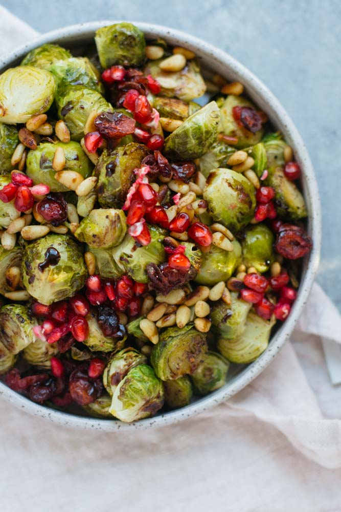 Roasted Holiday Brussels Sprouts make for an easy, crunchy side dish for Thanksgiving & holiday dinner parties. They're healthy, vegan and tasty!