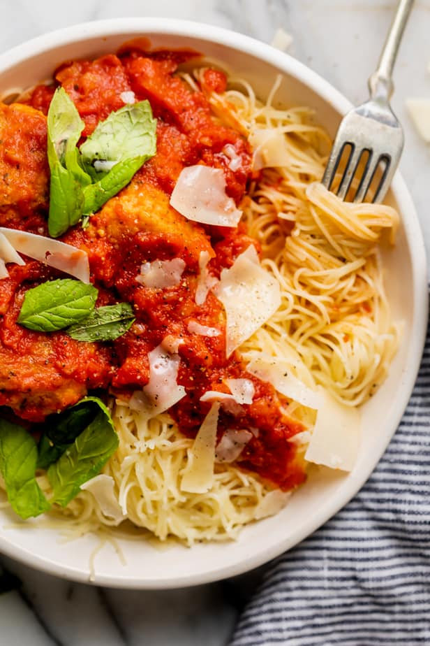 Chicken meatball recipe with marinara served over pasta