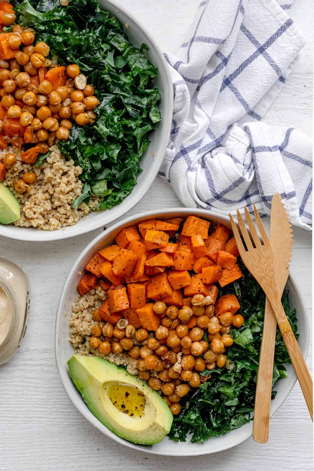 Two vegan buddah bowls made with quinoa, sweet potatoes and kale