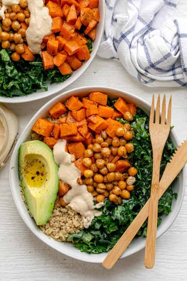 Quinoa buddha bowl made with chickpeas and sweet potatoes and topped with avocado