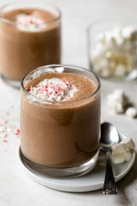 Vegan hot chocolate made with cashew milk and topped with crushed peppermint