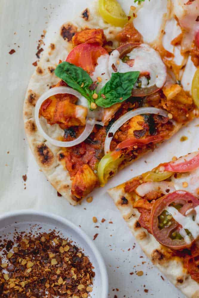 This Tomato Garlic Chicken Naan Pizza is a recipe I tried from the Meatballs and Masala cookbook by Asha Shivakumar. It uses naan bread as the base for the pizza and it's topped with a basic chicken masala, onions, tomatoes and fresh mozzarella. It will definitely get you out of your pizza rut!