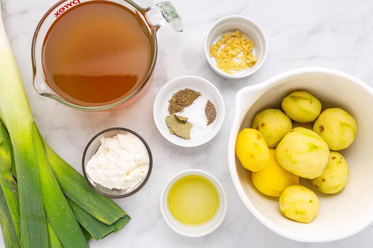 healthy potato leek soup in a white bowl