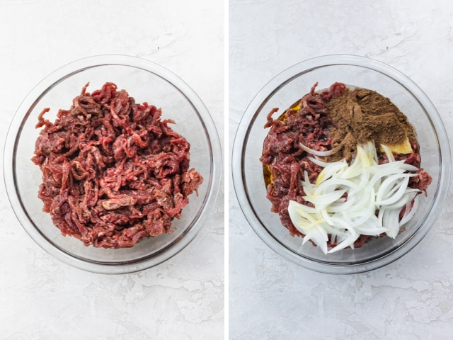 Large pot filled with raw shawarma meat marinated in the spices and covered with sliced onions, lemon slices and sumac.